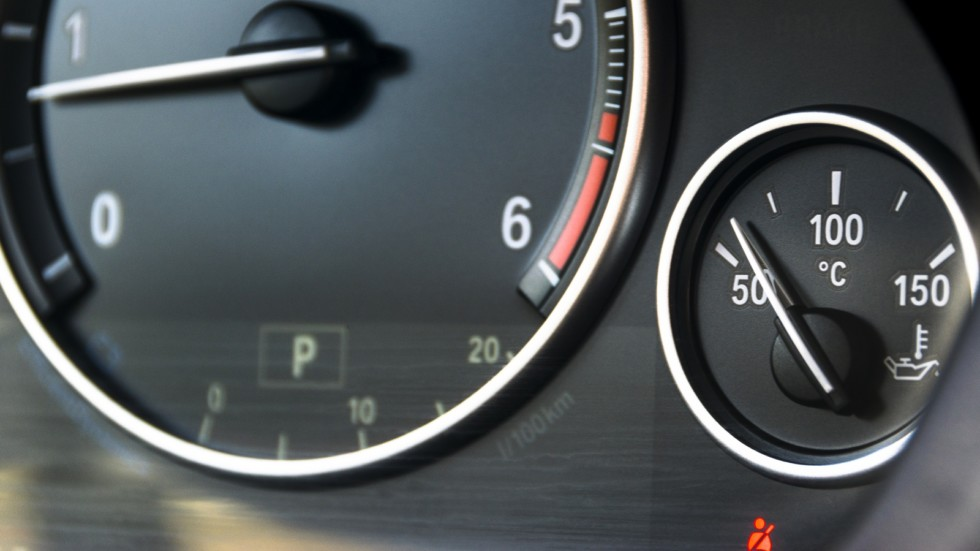 Coolant temperature gauge and tahometer on a car's dashboard. Ca